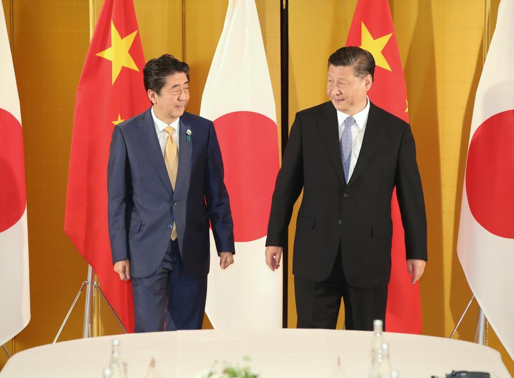 安倍晋三首相(左)と中国の習近平国家主席=大阪市北区(代表撮影)